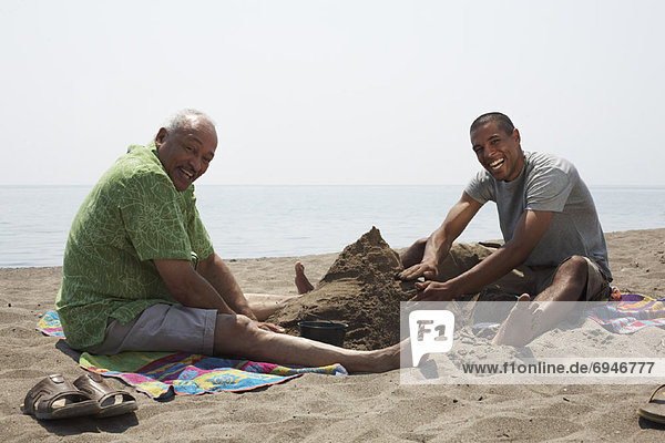 Father and Son Playing in Sand