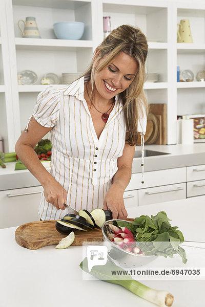 Woman in Kitchen  Preparing Food