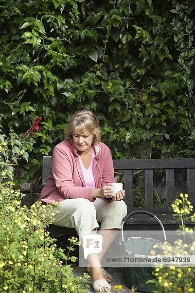 Woman Sitting in Garden