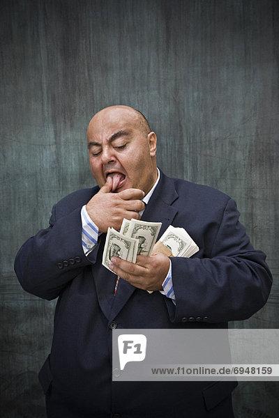 Portrait Geschäftsmann Geld