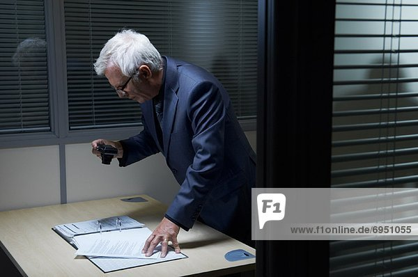 Businessman Photographing Document