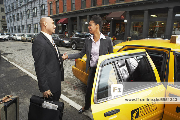 Business People Shaking Hands by Taxi  New York City  New York  USA