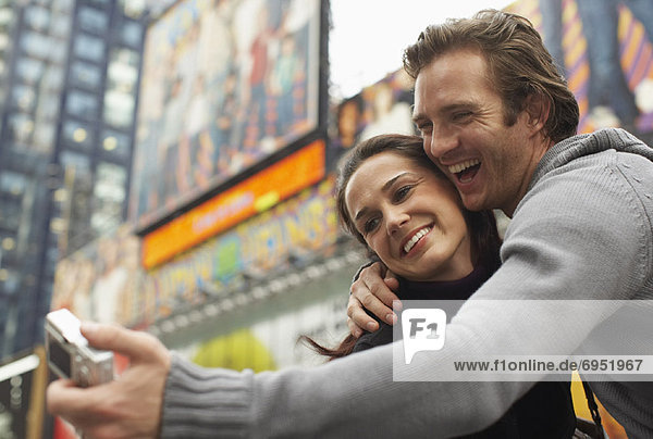Couple Taking Self Portrait in City  New York City  New York  USA