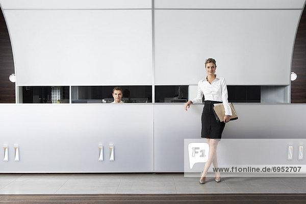 Geschäftsfrau  Schreibtisch  Empfangsdame