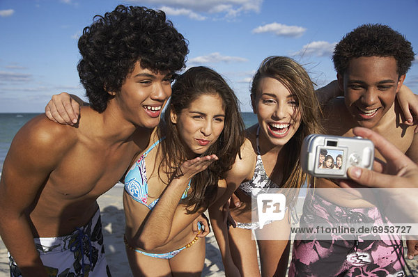 Friends Posing for Picture on Beach