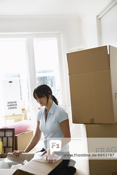 Woman with Boxes in Home
