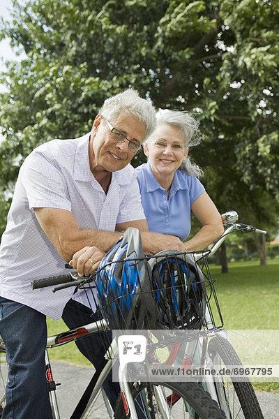 Baby-Boomer Couple Riding Bikes