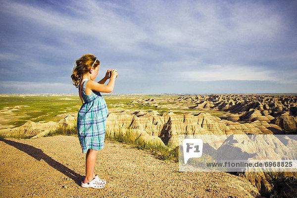 Girl Taking a Picture  Badlands  South Dakota  USA