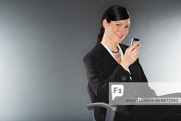 Geschäftsfrau Hand haltendy