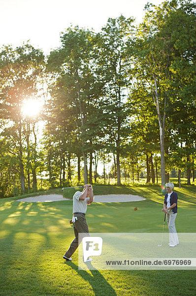 Couple Playing Golf  Burlington  Ontario  Canada