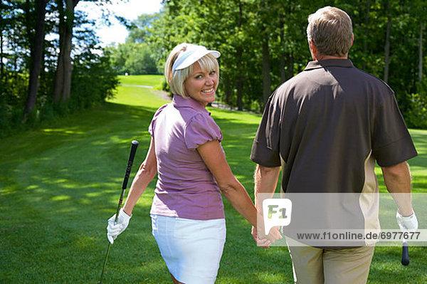 gehen  Golfsport  Golf  Rückansicht  Kurs