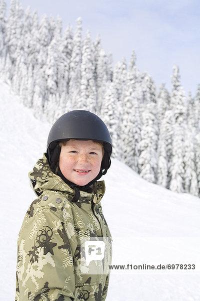 Little Boy Snowboarding at Snoqualmie Pass  Washington  USA
