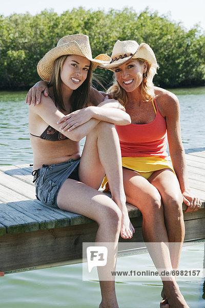 Two Women Sitting on Dock  Florida  USA