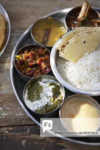 Thali  Kadai Bhindi  Mixed Vegetable Curry  Sambhar  Saag Paneer  Payasam  and Chapati