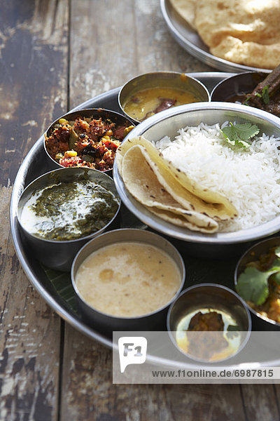 Thali  Kadai Bhindi  Mixed Vegetable Curry  Sambhar  Saag Paneer  Payasam  Mixed Pickle  and Chapati
