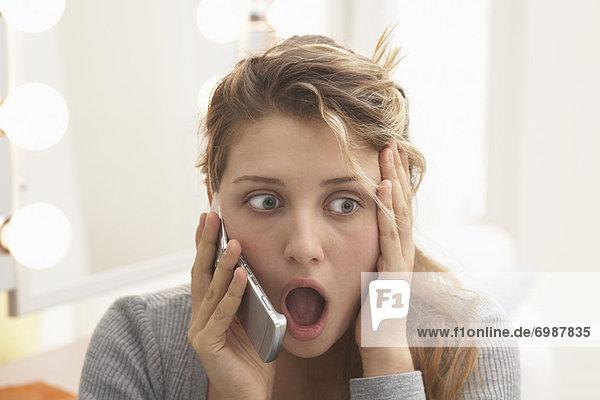 Teenager Talking on Cellular Telephone