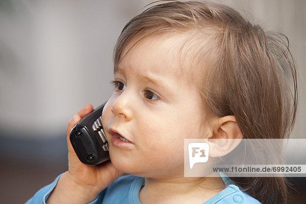 Boy am Handy sprechen