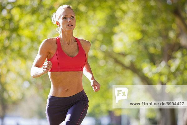 Woman Running in the Park  Seattle  Washington  USA