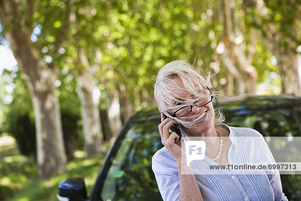 Woman Talking on iPhone  France