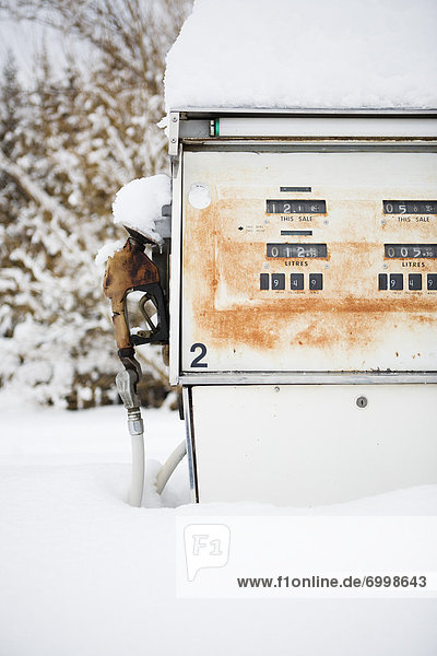 Vintage Gas Pump Covered in Snow,  British Columbia,  Canada