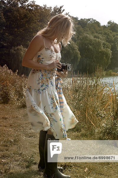 Woman Holding Folding Camera  High Park  Toronto  Ontario  Canada