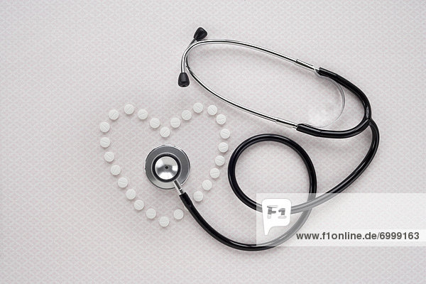 Pills in Heart Shape and Stethoscope