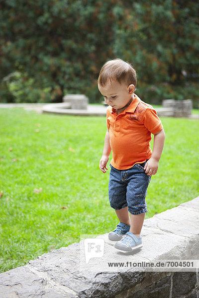Boy Walking on Stone Wall  Washington Park  Portland  Oregon  USA