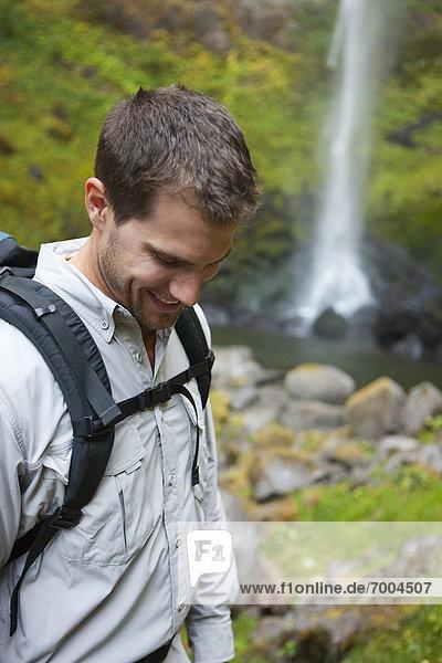 Man Hiking by Waterfall  Hood River  Oregon  USA