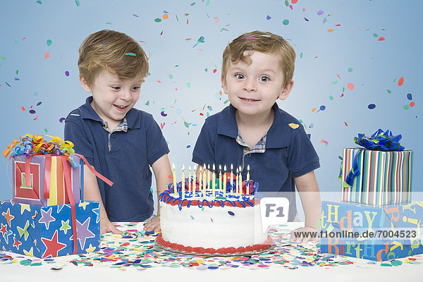 Twin Boys with Birthday Cake and Presents