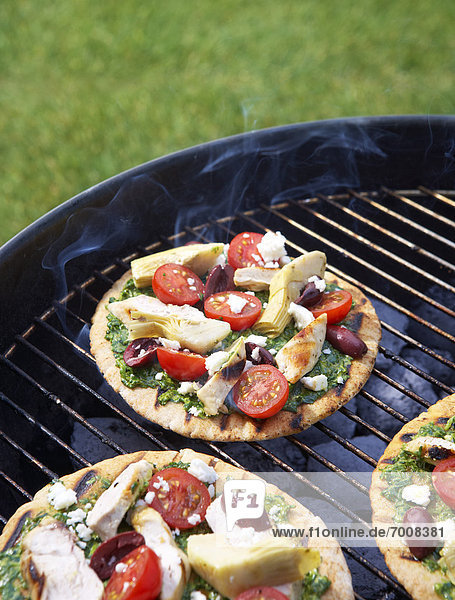 Homemade  Gourmet Pizzas on Barbecue Grill