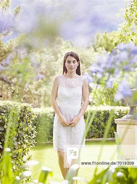 Smiling woman standing in garden