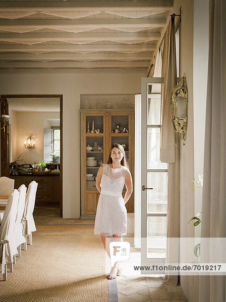 Woman standing in dining room