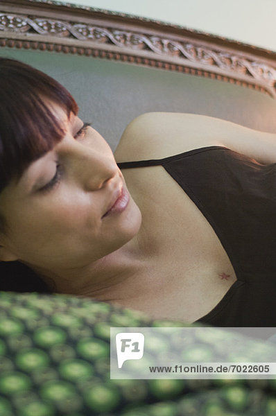 Woman lying on side  looking away in thought Woman lying on side, looking away in thought