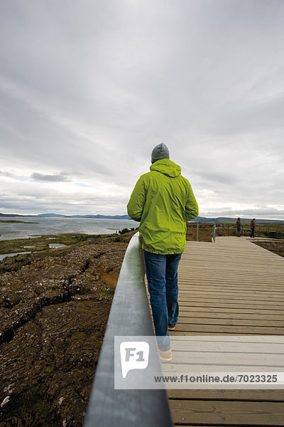 Tourist walking in Pingvellir (Thingvellir) National Park  Iceland