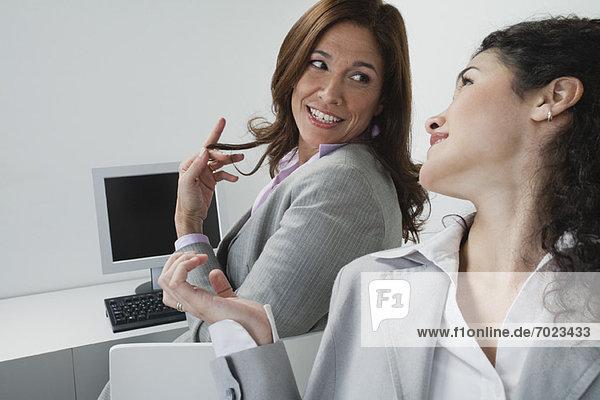 Women chatting in office