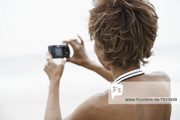 Frau  Fotografie  nehmen  Strand  Rückansicht  Ansicht