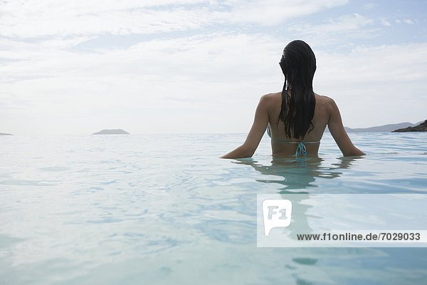 Young woman standing in water  St. John  US Virgin Islands  USA