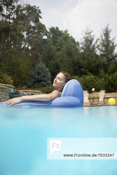 Mid-Adult Woman on Pool Raft