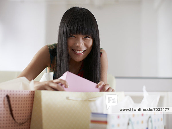 Happy Woman Opening Shopping Bags
