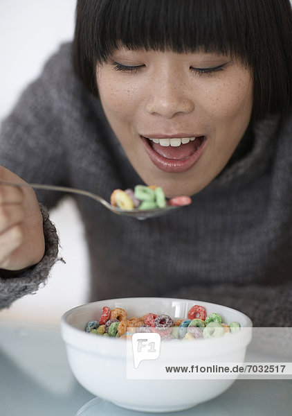 Mid-Adult Woman Eating Breakfast Cereals