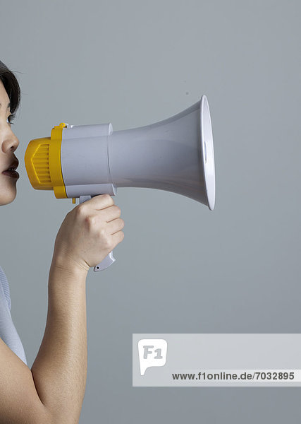 Mid-Adult Woman Using Megaphone