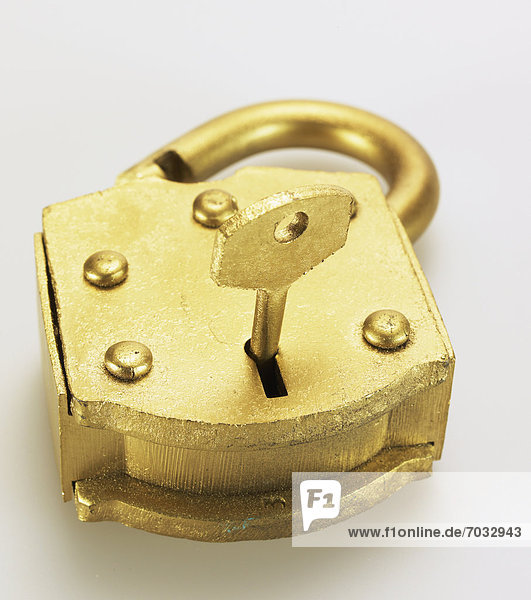 Key in Golden Padlock