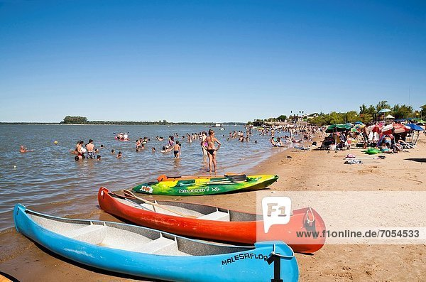 People on the beach by the Uruguay River  Colon  Entre Rios Province  Argentina