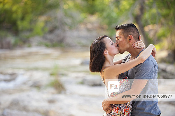 USA  Texas  Leakey  Young couple kissing  close up