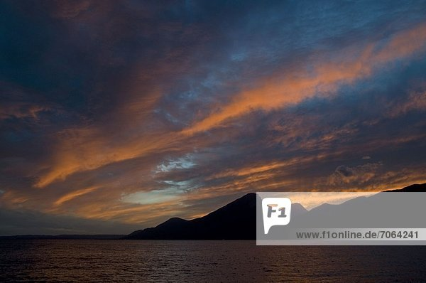 Mandatory Credit: Photo by Richard Sowersby / Rex Features (1910736v) The evening sun sets off a blaze of a mixture of colours over Lake Garda from Torri del Benaco on the east side  Italy Italy - Sep 2012