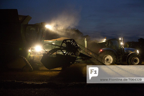 Mandatory Credit: Photo by Tim Scrivener / Rex Features (1906453d) Farmers across the country make the most of the dry spell to work late into the night harvesting wheat under floodlights. Fears that the cost of Bread will rise as farmers across Europe and United States of America report poor yields due to extreme weather conditions. Uffington  Stamford  Lincolnshire. Various - Sep 2012