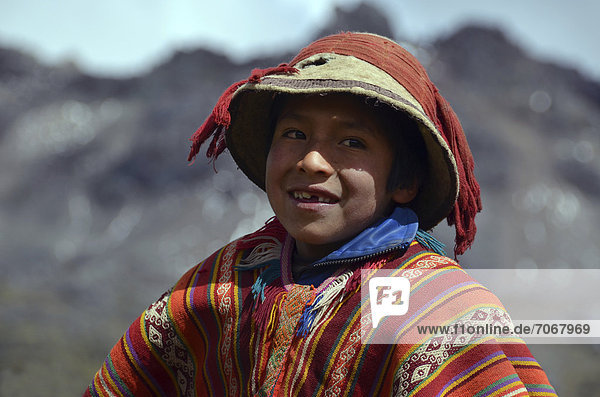 Indigenous boy in traditional clothes  in the Andes near Cusco  Cuzco  Peru  South America