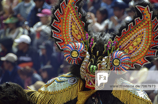 Dancer with a mask at the world's biggest Indian carnival festival  living UNESCO World Heritage Site  Diablada  Oruro  Bolivia  South America