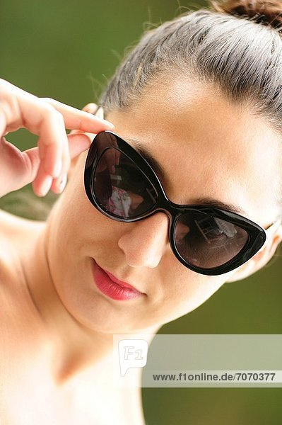 Portrait of young woman with susglasses. Portrait of young woman with susglasses