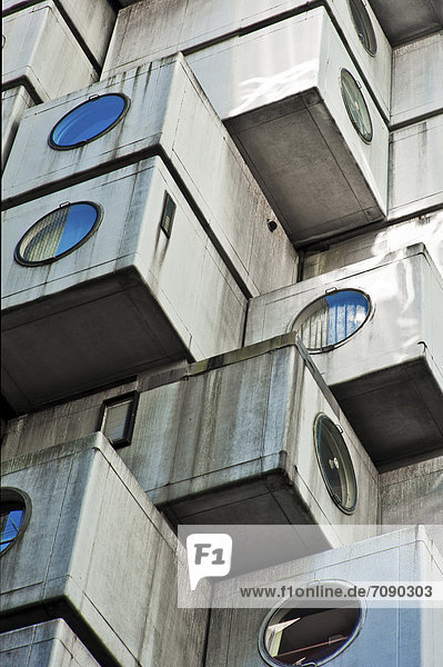 The Akagin Capsule Tower in Ginza  a famous Japanese Metabolist concrete building by Kisho Kurokawa. Modern architecture.